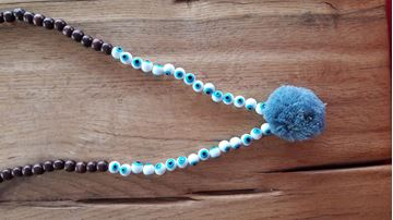 Picture of wooden necklace with pompon